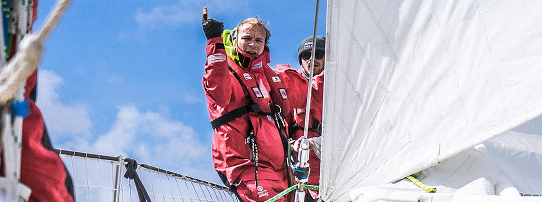 Dmitry on the bow of his team yacht Sanya Serenity Coast