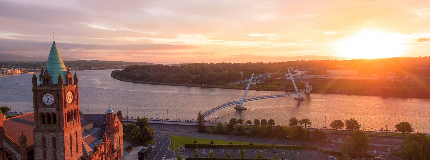 Sun rises over the city of Derry~Londonderry and it's iconic Peace Bridge