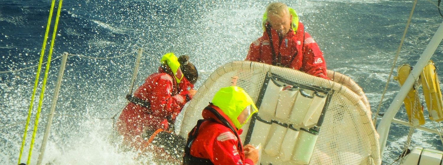 Andrew Jagoe-Salter on the helm being hit by a big wave