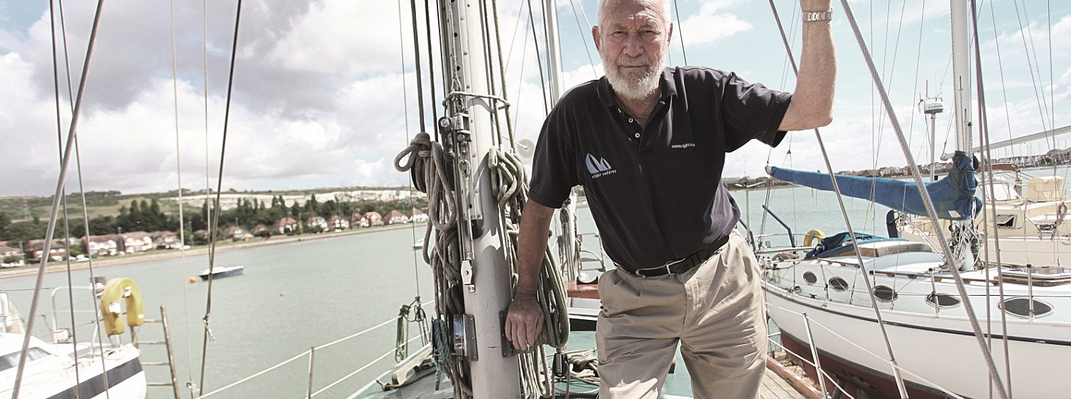 Sir Robin on deck of his refurbished Suhaili