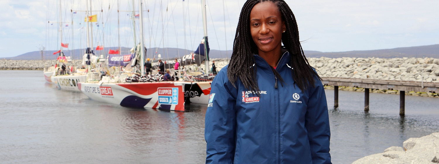 Abi Oyepitan in front of the GREAT Britain boat