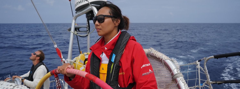 Zhang Shan tailing a staysail sheet