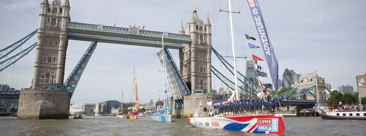 Clipper Race fleet pass under Tower Bridge London during 2013-14 race