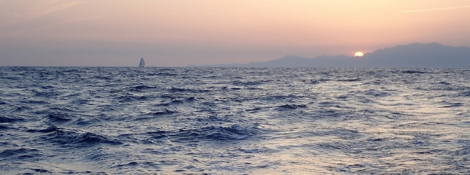 Dare To Lead pictured sailing in the distance under sunset