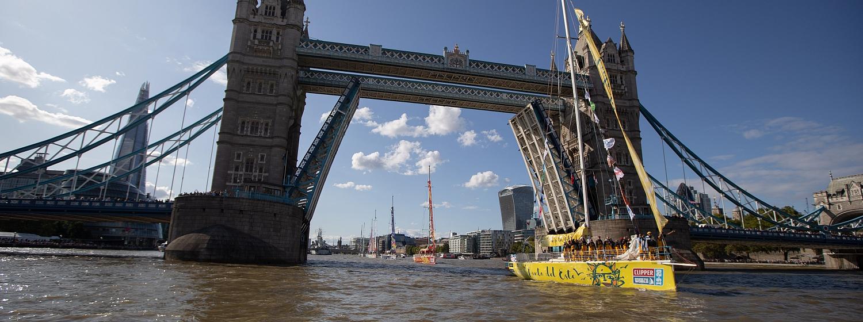 Clipper Race fleet passes under Tower Bridge