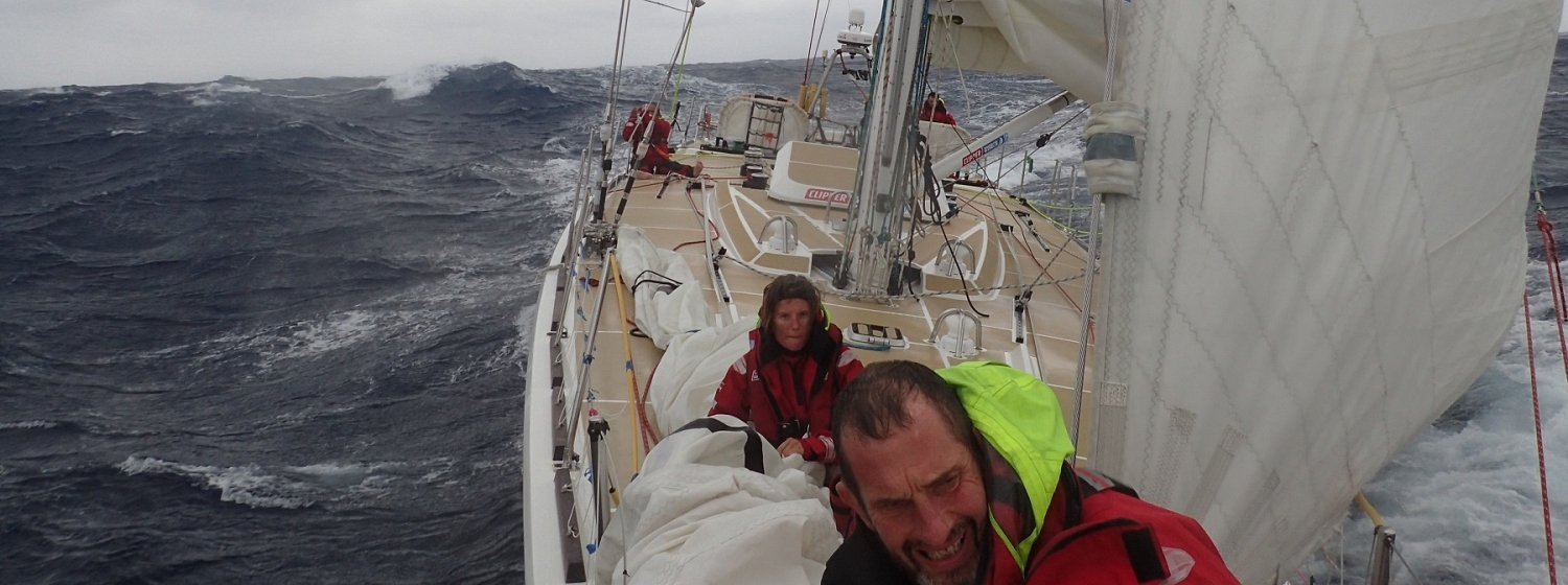 Crew members pictured on deck during stormy conditions