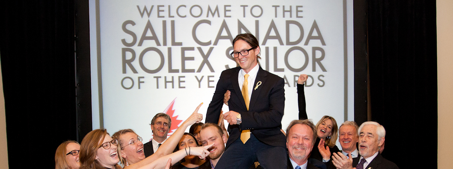 Eric Holden shown celebrating with former crew mates at the Sail Canada Awards