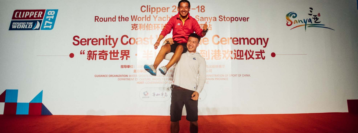 Fan on stage with Qingdao Ambassador, Hungry, during the recent Sanya Stopover