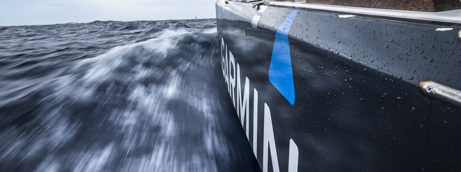The hull of the Garmin boat shown whipping through the water