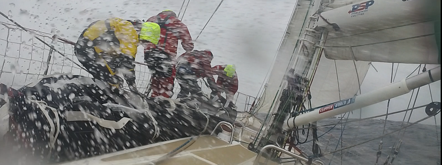 Liverpool 2018 crew take a sail bag up the bow in squally conditions