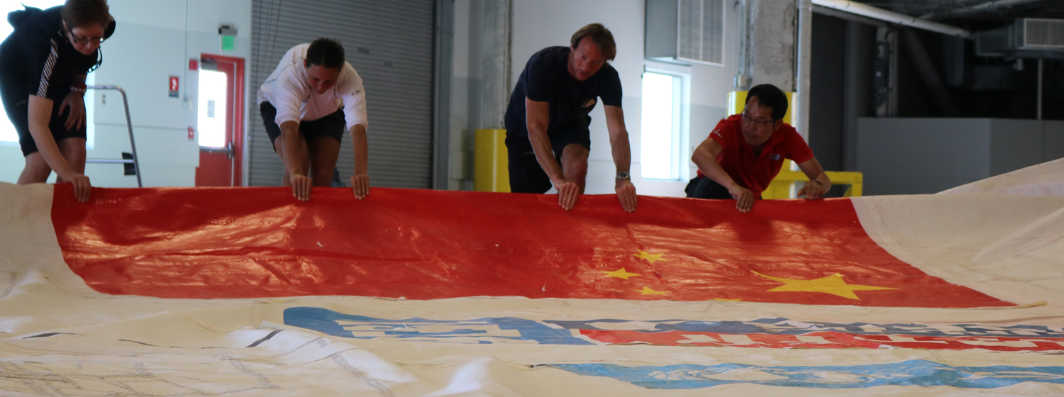 Qingdao crew gather the mainsail