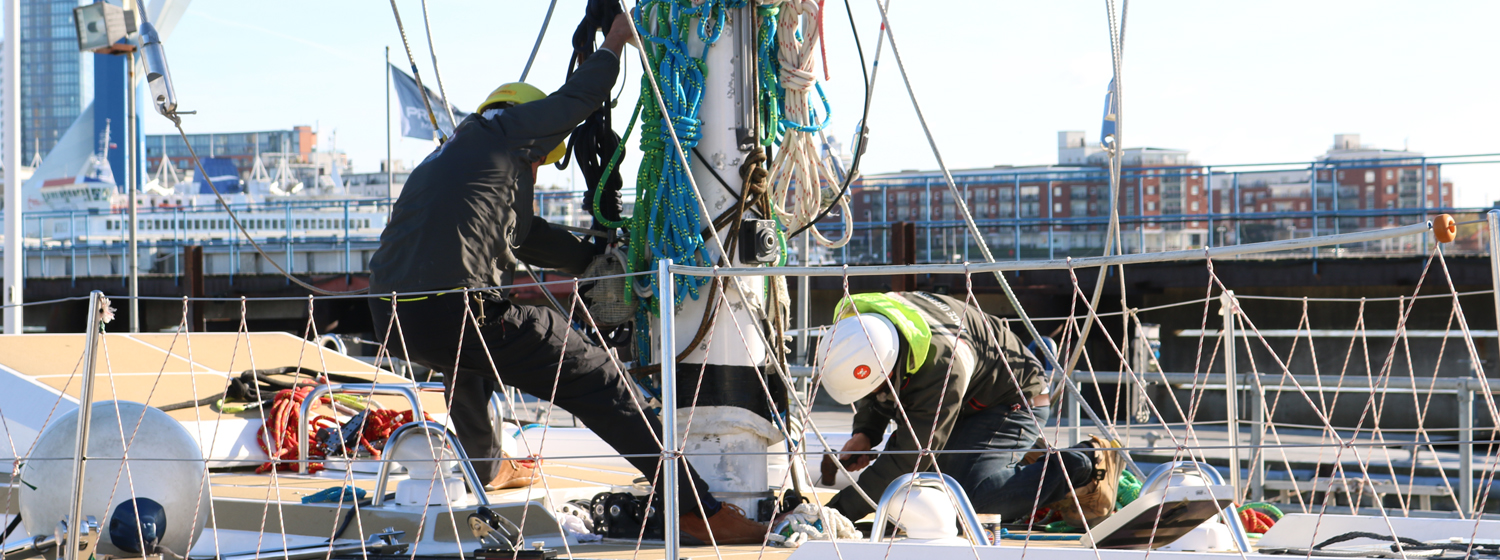 Clipper 70 mast being stepped at race HQ