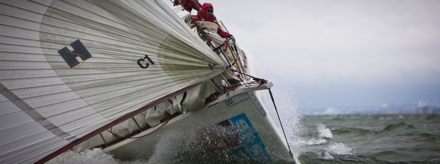 The bow of a Clipper yacht pictured racing