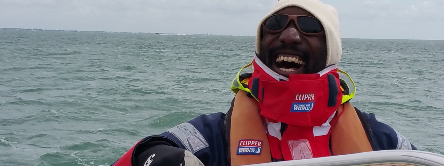 Boris behind the helm in full foul weather gear on his Level 2 training