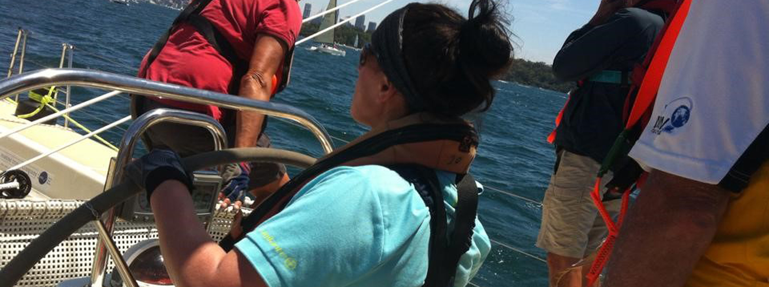 Nicola Edwards behind the helm in Sydney on her Clipper Race training
