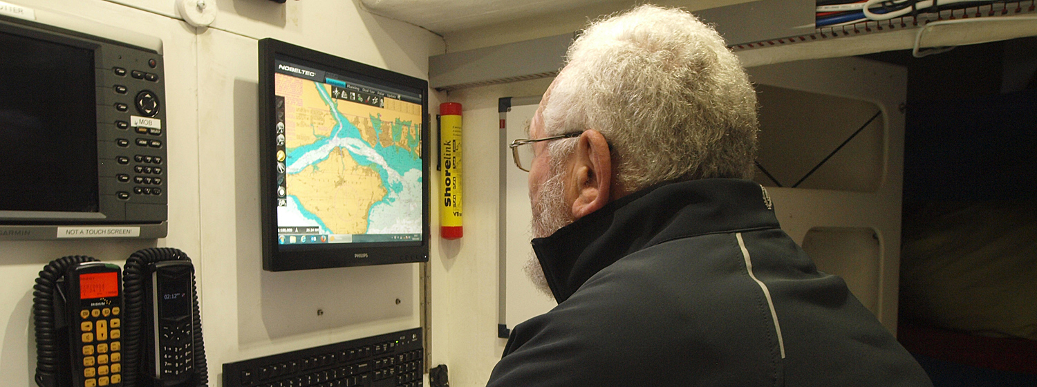 Sir Robin pictured looking at the Nobeltec navigation screen onboard a Clipper 70 yacht