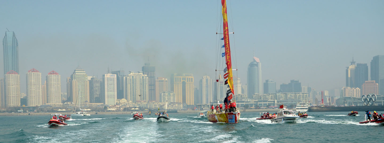 Qingdao leaves its homeport during the Clipper 2013-14 Race