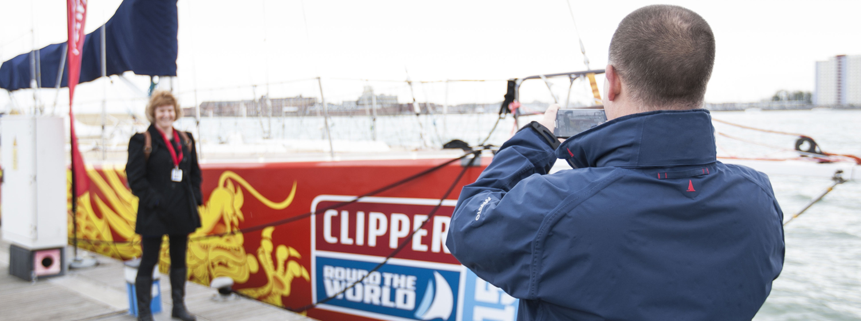 Visitors touring a Clipper 70 open boat