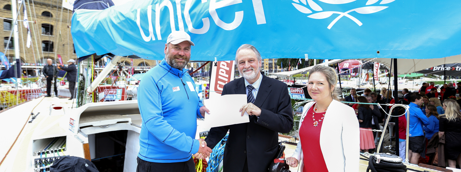 Pictured: Unicef skipper Jim Prendergast received the children's letter at the race start in London from David Bull, Executive Director and Catherine Cottrell, Deputy Executive Director of Unicef UK.