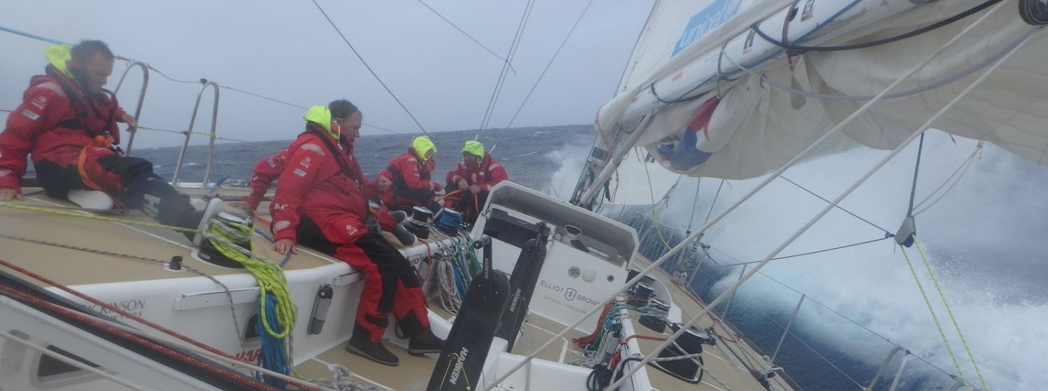 Crew members shown in big waves on board PSP