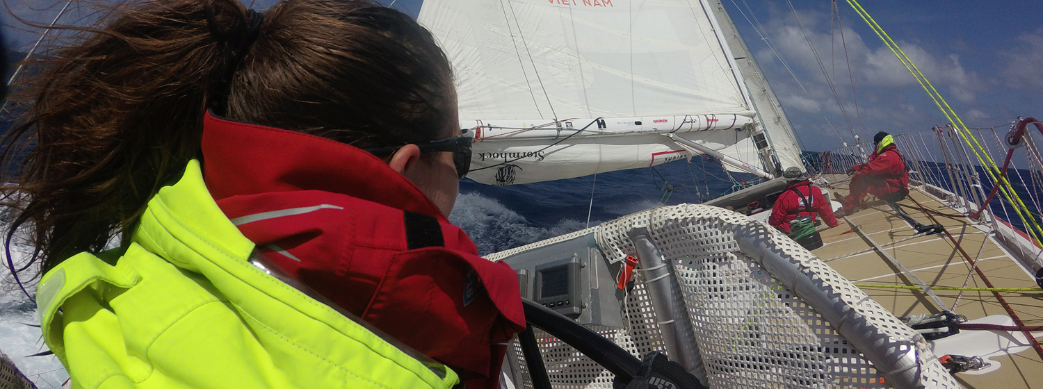 Pippa Moore helming across the Atlantic