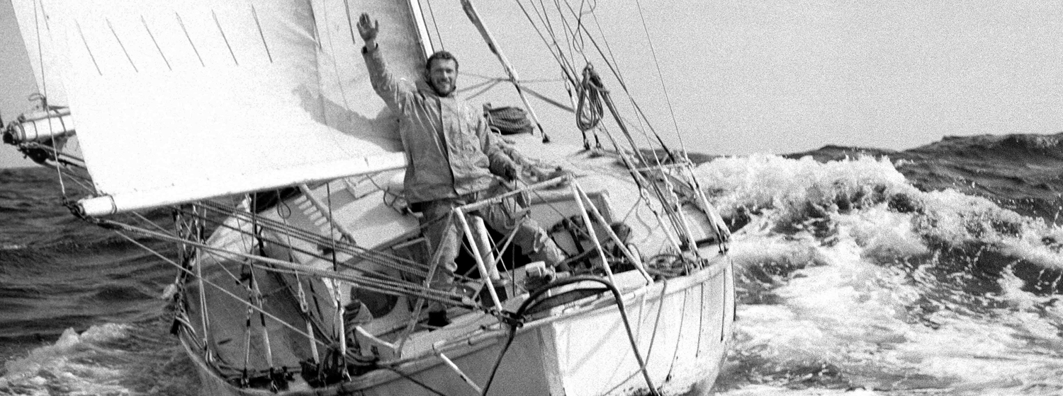 Sir Robin celebrates his victory on board Suhaili