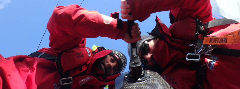 Crew members using the Harken grinder