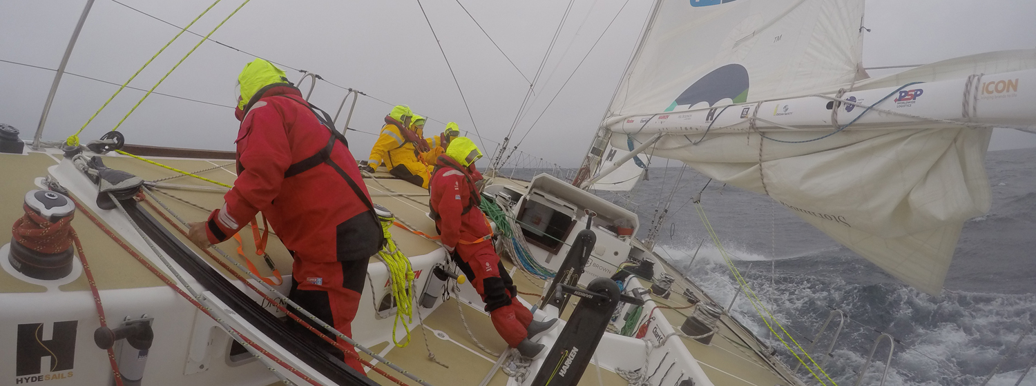 Crew shown racing on board at 30 degree angle