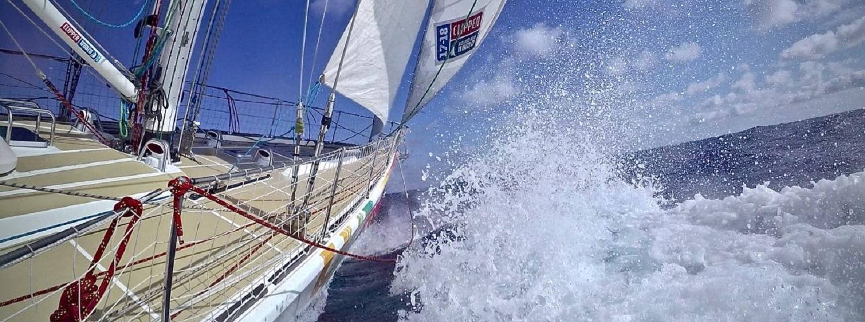 Sanya Serenity Coast bashes upwind through a wave