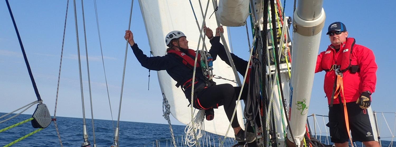 Crew member seen preparing to climb mast