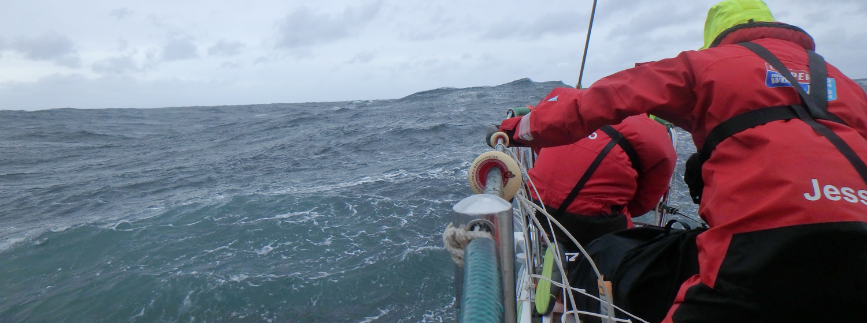 Crew members racing in the Southern Ocean