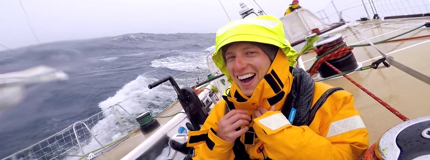 Zhuhai crew member Chris Ball smiling after getting soaked by a wave
