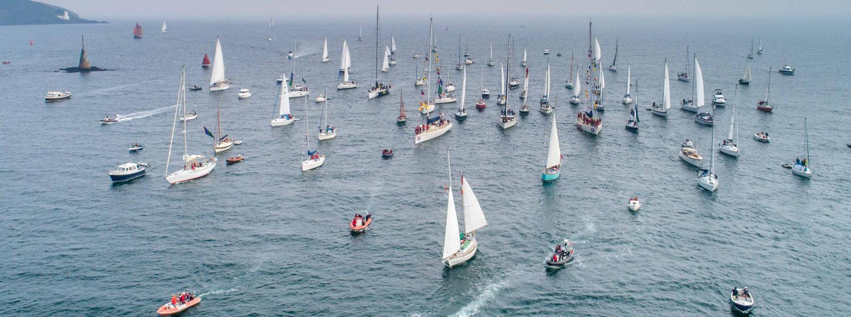 Flotilla escorting Sir Robin Knox-Johnston and Suhaili in Falmouth