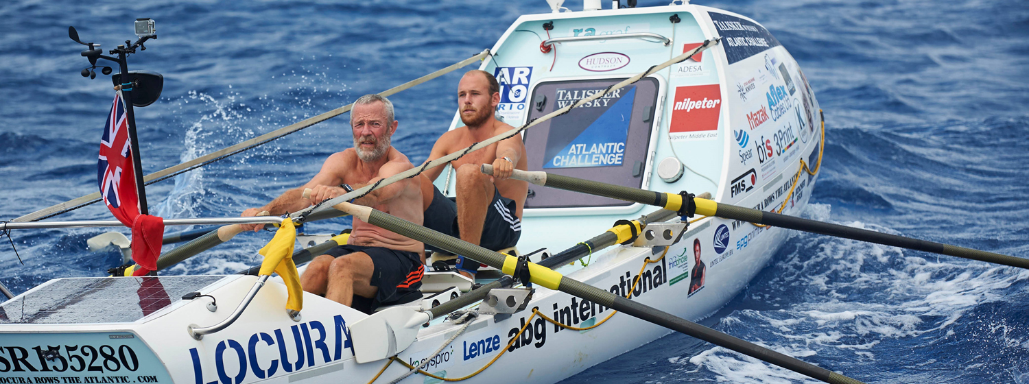 Tom Salt and fellow Clipper Race crew member Mike Burton on board the Tallisker Whisky Atlantic Rowing Challenge