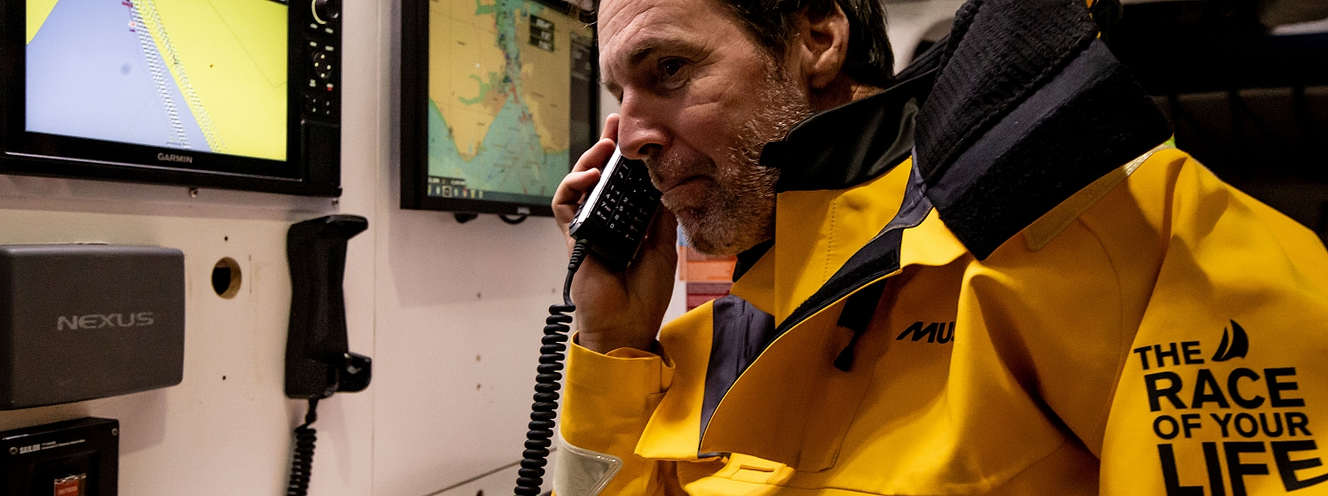 Skipper using satellite phone