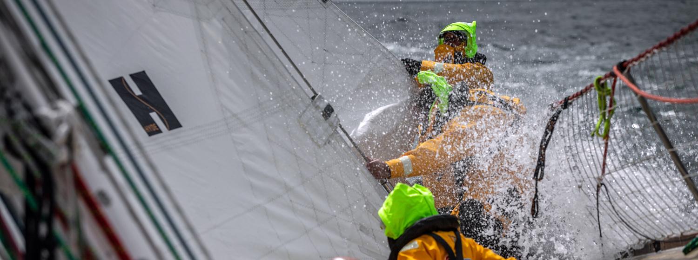 Clipper Race crew change a headsail
