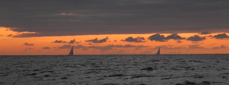 yachts on the horizon at sunrise