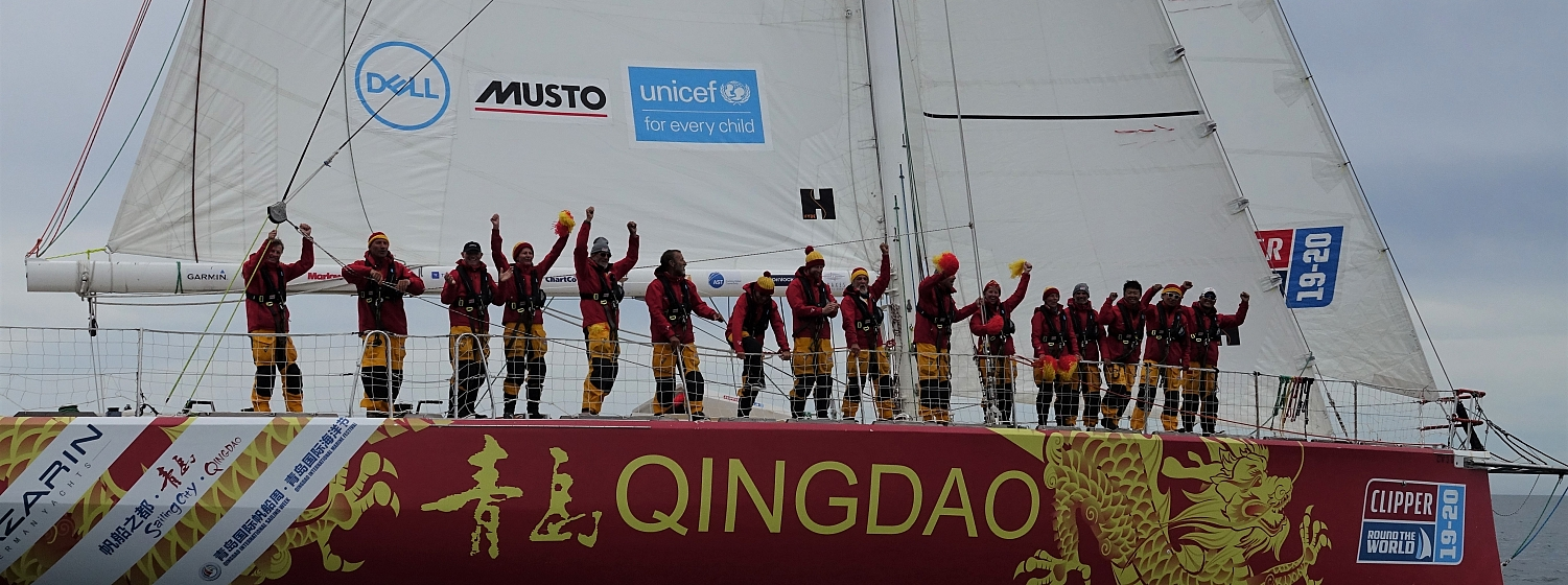 The crew of Qingdao celebrate winning first place into Punta del Este