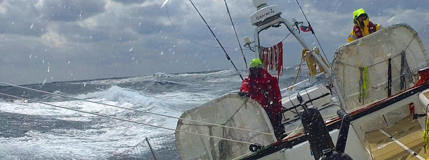 Fernando Arechiga helming on board Dare To Lead in the North Pacific Ocean.