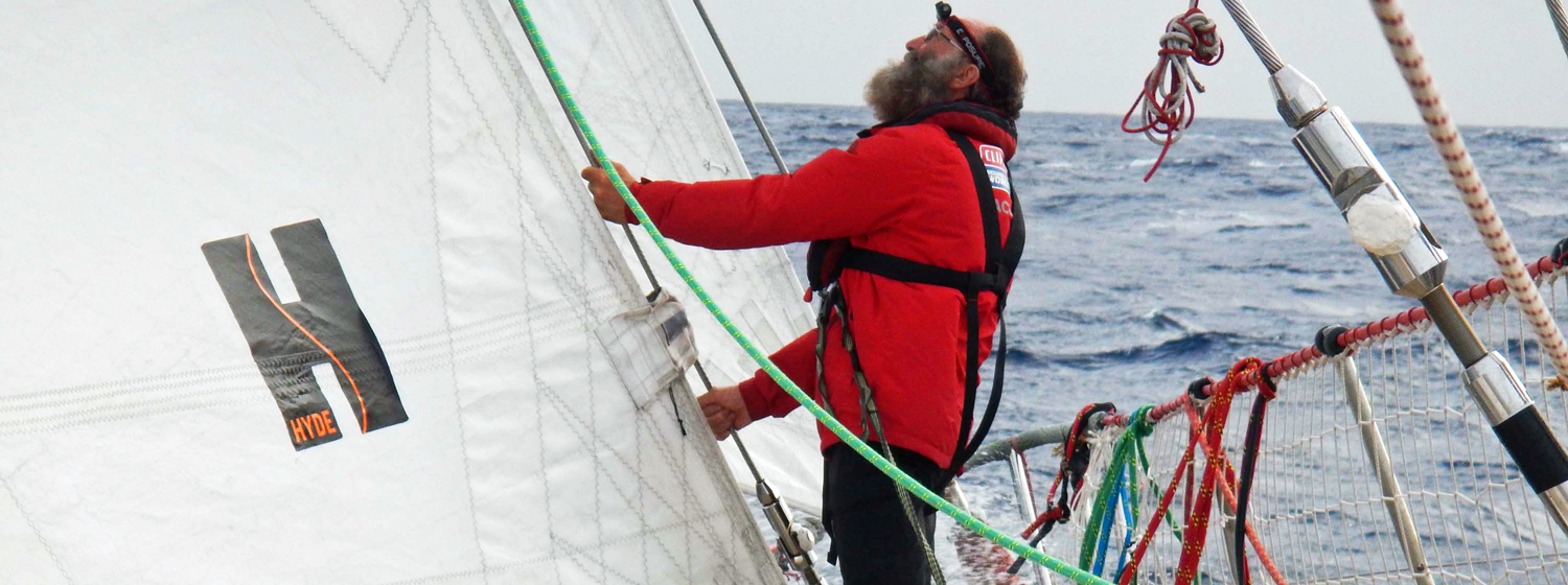 Mike Sweet at the bow of Qingdao during Race 11 in the Caribbean